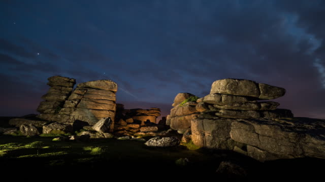 time lapse of illuminated rock formations in dartmoor national park at night - blurred motion stock videos & royalty-free footage