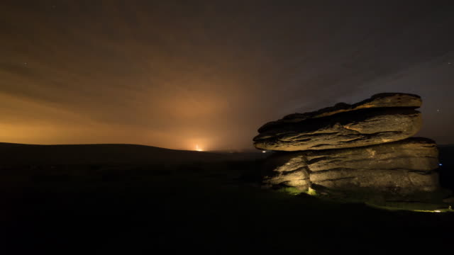 time lapse of illuminated rock formations in dartmoor national park at night - dartmoor stock videos & royalty-free footage