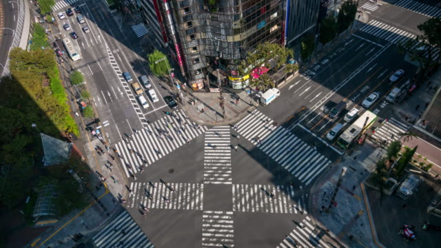 time lapse of intersection cross-walk , ginza crosswalk and more car and people in rush hour , tokyo japan - crosswalk stock videos & royalty-free footage