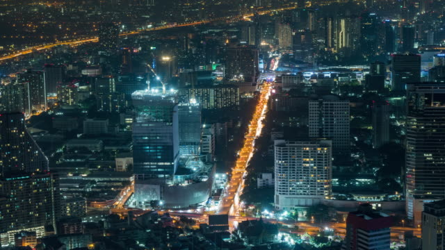 4k time lapse of intersection with traffic jam and building construction in rush hour at night time in bangkok, transportation with cityscape concept - rail transportation stock videos & royalty-free footage