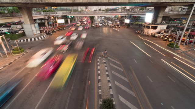 4k time lapse of intersection with traffic jam in rush hour after worker worked at evening time, transportation with cityscape concept  with zoomming technic - bangkok stock videos & royalty-free footage