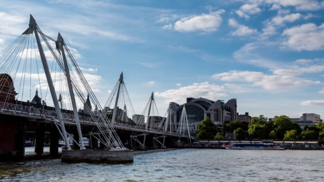 vídeos y material grabado en eventos de stock de london - circa 2013: time lapse of jubilee bridge and charring cross during a sunny and coudy day  - 2013