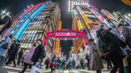 4K Time lapse of Kabukicho night time with crowd undefined people walking on the street cross-walk with car traffic in Shinjuku Tokyo city, Japan. Japanese culture and shopping neon street concept