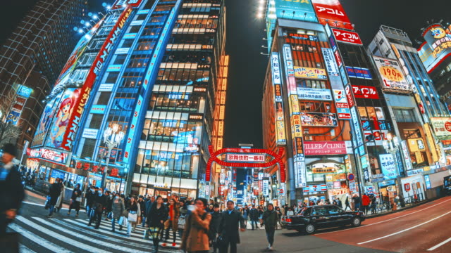 vídeos de stock e filmes b-roll de time lapse of kabukicho night time with crowd undefined people walking on the street in shinjuku tokyo city, japan - vida noturna