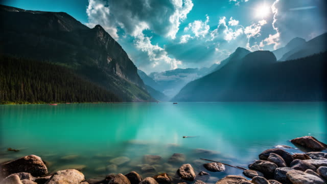 time lapse of lake louise in canada - light effect stock videos & royalty-free footage