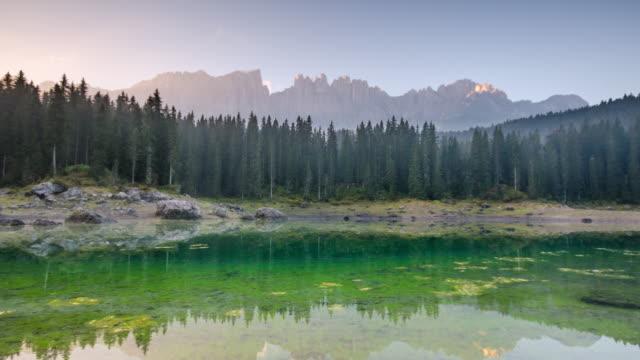 Time Lapse of lake of carezza sunrise time , dolomites south tyrol Italy