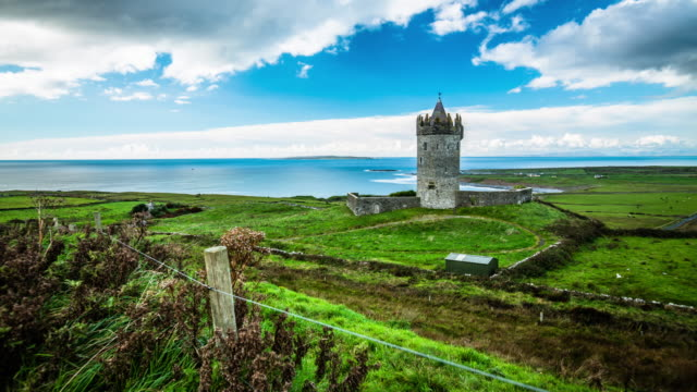 time lapse of landscape in ireland, doonagore castle - ireland stock videos and b-roll footage