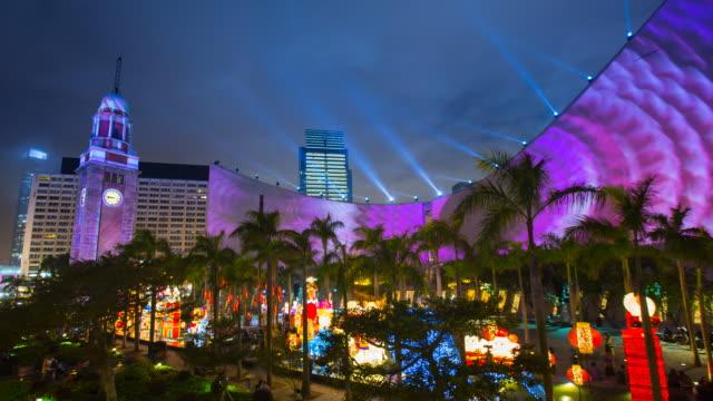 time lapse of lightshow tsim sha tsui, kowloon, hong kong at night - tsim sha tsui stock videos & royalty-free footage
