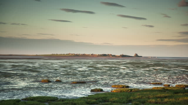 time lapse of lindisfarne at sunset - northumberland stock videos & royalty-free footage