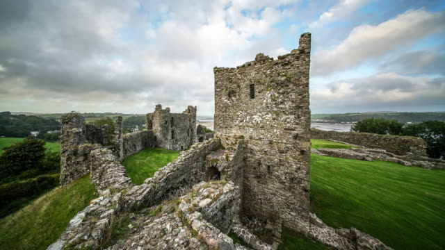 time lapse of llansteffan castle, wales. - wales stock videos & royalty-free footage