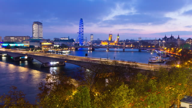 time lapse of london and the river thames at night shot from the roof of somerset house showing the millennium wheel waterloo bridge westminster and boat traffic - the strand london stock videos and b-roll footage