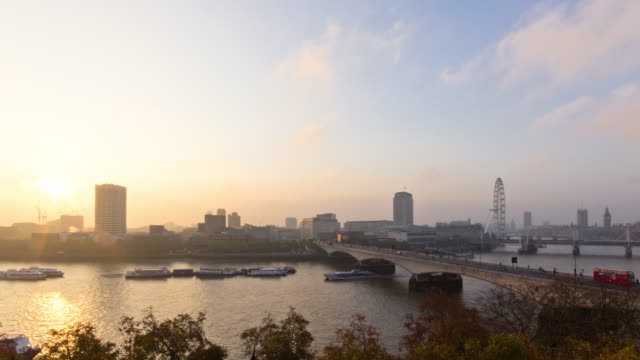 time lapse of london and the river thames with sunrise shot from the roof of somerset house showing the millennium wheel waterloo bridge westminster and boat traffic - the strand london stock videos and b-roll footage