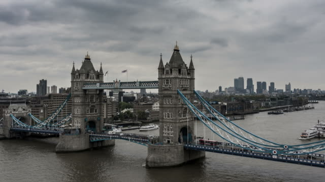LONDON - CIRCA 2012: Time lapse of London skyline from Tower Bridge in a sunny and cloudy day