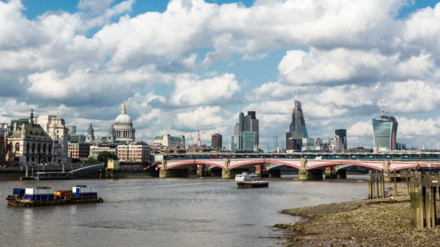 london - circa 2013: time lapse of london skyline in a cloudy sunny day by the river thames an low tide - 2013 stock videos & royalty-free footage