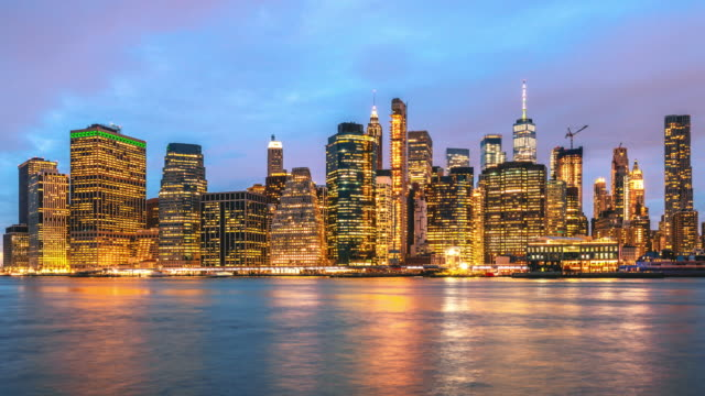 time lapse of lower manhattan financial district cityscape with day to night time in new york, united states - day to night time lapse stock videos & royalty-free footage