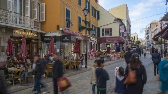 time lapse of main street, gibraltar's main commercial and shopping district, gibraltar, uk - gibraltar bildbanksvideor och videomaterial från bakom kulisserna