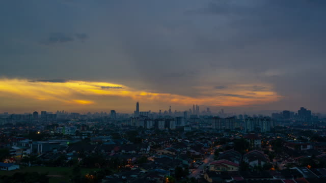 4K Time lapse of majestic sundown over downtown Kuala Lumpur, capital city of Malaysia. Zoom In.