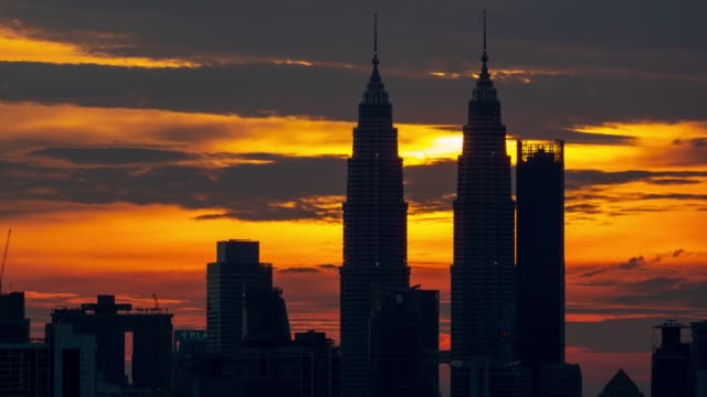 4k time lapse of majestic sunset over down town kuala lumpur - petronas twin towers stock videos & royalty-free footage