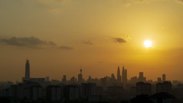 4K Time lapse of majestic sunset over downtown Kuala Lumpur, Malaysia.