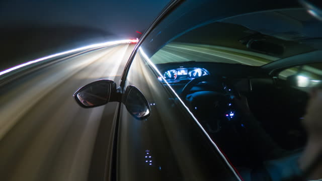 time lapse of man driving car at night on highway - wing mirror stock videos & royalty-free footage