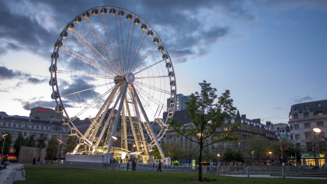 4k time lapse of manchester´s big wheel on the city center, england - manchester england stock videos & royalty-free footage