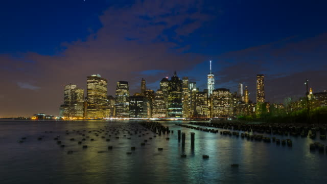 Time Lapse of Manhattan financial district skyline and pilings, day to night