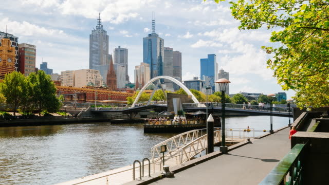 4K Time lapse of Melbourne with Yarra river, skyline and Flinders station, Victoria, Australia
