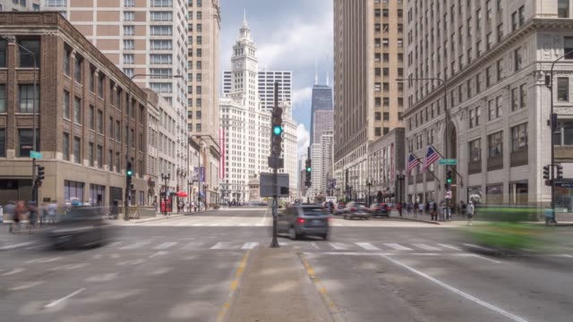 time lapse of michigan avenue and the wrigley building, chicago, illinois, united states of america, north america - time stock videos & royalty-free footage