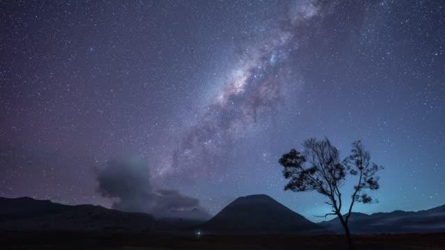 time lapse of milky way bromo volcano indonesia. - mount semeru stock videos & royalty-free footage