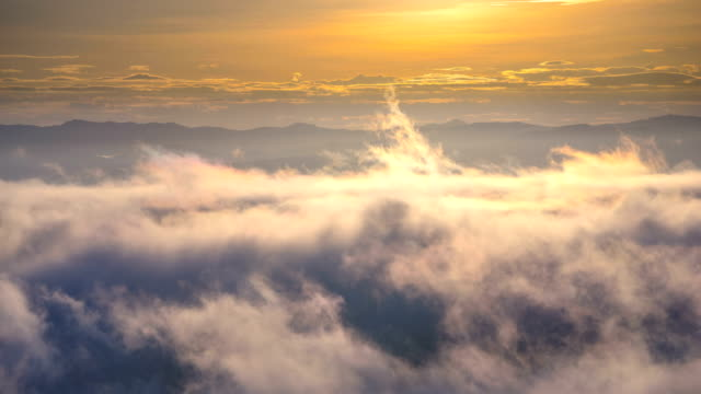 4k t/l time lapse of mist fog cloud fast moving with mountain range in the morning - mack2happy stock videos and b-roll footage