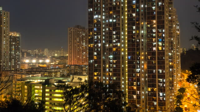 time lapse of mong kok apartment blocks, day to night - mong kok stock videos and b-roll footage