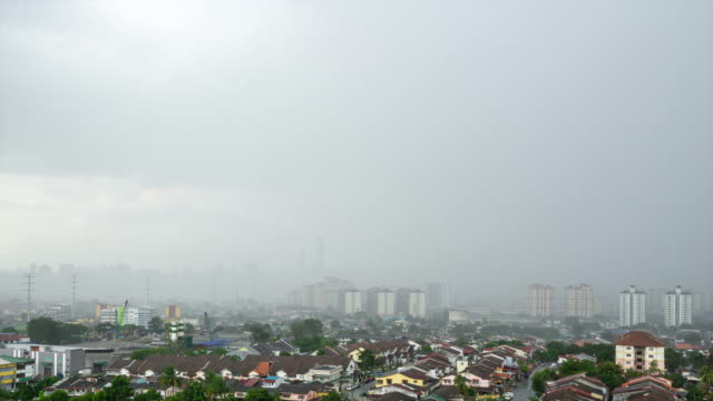 4k time lapse of monsoon clouds over kuala lumpur, malaysia - monsun stock-videos und b-roll-filmmaterial