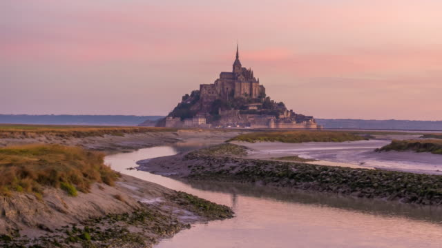 Time lapse of Mont Saint-Michel view with sunset light in Normandy