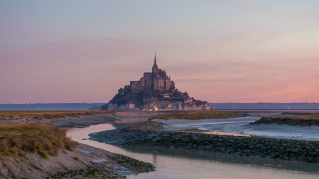 time lapse of mont saint-michel view with sunset light in normandy - normandy stock videos and b-roll footage