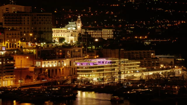 time lapse of monte carlo casino and port hercule in monaco at night - spoonfilm stock-videos und b-roll-filmmaterial