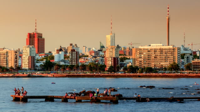 time lapse of montevideo's coastline at sunset - モンテビデオ点の映像素材/bロール