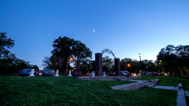 Time Lapse of Moon During Dusk Over Park