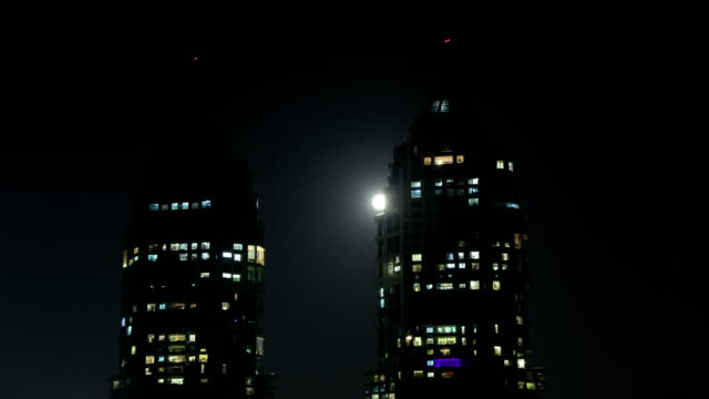 Time lapse of moon-rise and twin towers of Mumbai