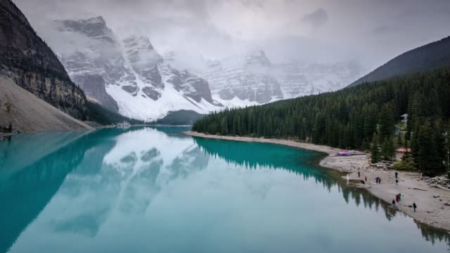 time lapse of moraine lake in canadian rockies banff national park alberta canada , time lapse right to left movement - valley of the ten peaks stock videos and b-roll footage