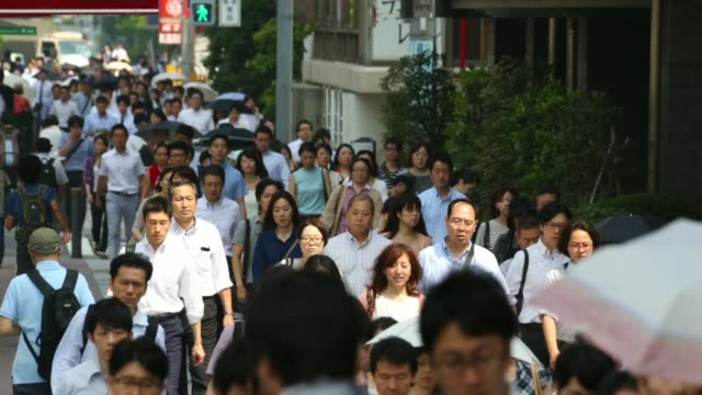 Time lapse of morning commuters make their way to work in Tokyo Japan on Thursday July 16 2014