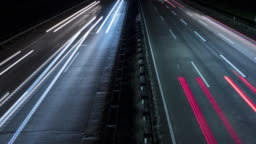 Time lapse of motion blurred headlights - highway high-angle view