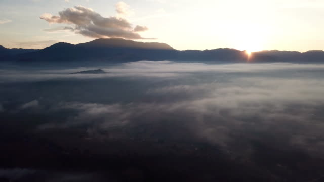 time lapse of mountain and sunrise , moving mist above the clouds - horizon over land stock videos & royalty-free footage