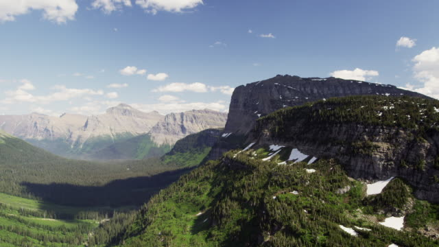 time lapse of mountaions and clouds in glacier national park - glacier national park us stock videos and b-roll footage