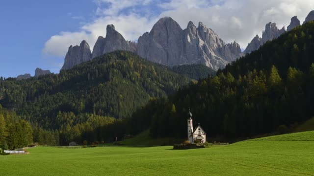 Time Lapse of moving cloud at St.Johann church, Dolomites, Italy