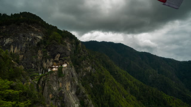 time lapse of moving cloud at tiger nest temple, bhutan - bhutan stock videos & royalty-free footage