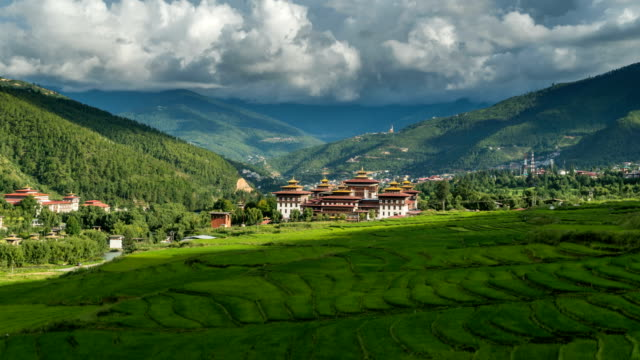 time lapse of moving cloud over ancient thimphu palace - palace stock videos & royalty-free footage