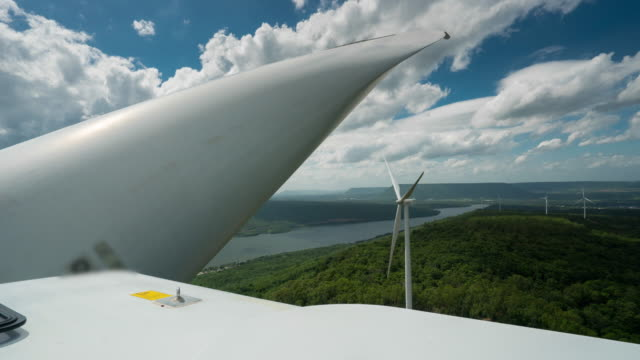 time lapse of moving cloud over wind turbine electric generator - mitochondrion stock videos & royalty-free footage