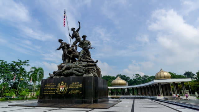 4K time lapse of moving clouds over National Monument or 'Tugu Negara' in Kuala Lumpur.