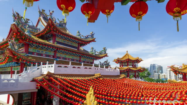 4k time lapse of moving clouds over thean hou temple in kuala lumpur, malaysia. - malaysia stock videos & royalty-free footage