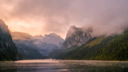 Time Lapse of Moving Fog and Mist in Morning, Beautiful scenery landscape of Gosausee mountain lake in fall. Salzkammergut region Upper Austria